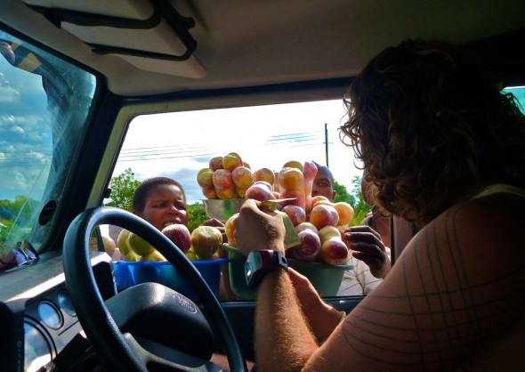 Lachlan buying fruit from car window, Rusape, Zimbabwe.