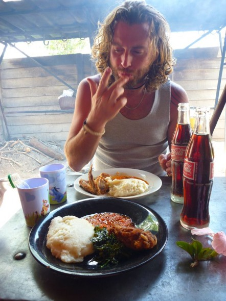 Lachlan eating sadza and licking fingers, Rusape, Zimbabwe.