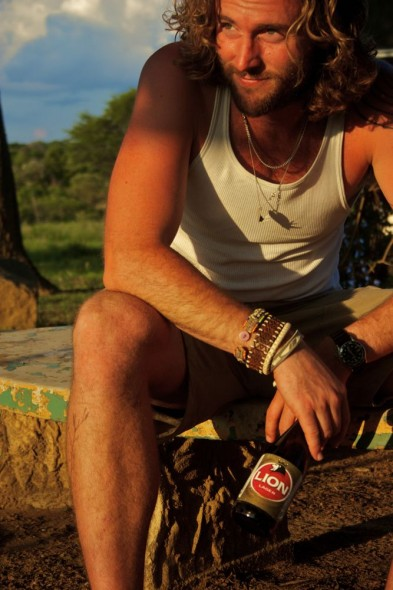 Lachlan with Lion beer sitting at Crocodile Motel, Rusape, Zimbabwe.
