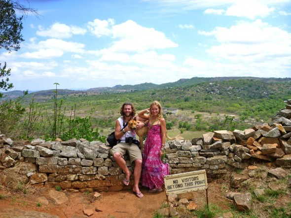 Lucie, Lachlan & Bow Wow at the Great Zimbabwe Ruins with the Queens' residence in the background.