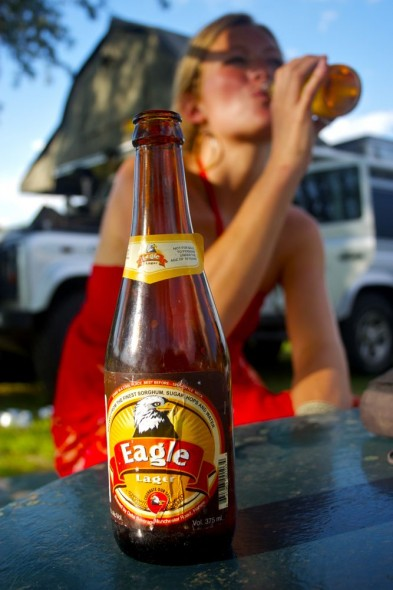 Lucie behind Eagle beer bottle at Crocodile Motel, Rusape, Zimbabwe.