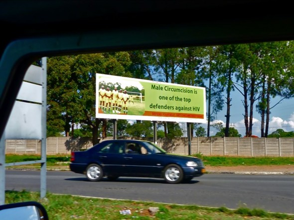 Male circumcision is one of the top defenders against HIV billboard, Harare, Zimbabwe.