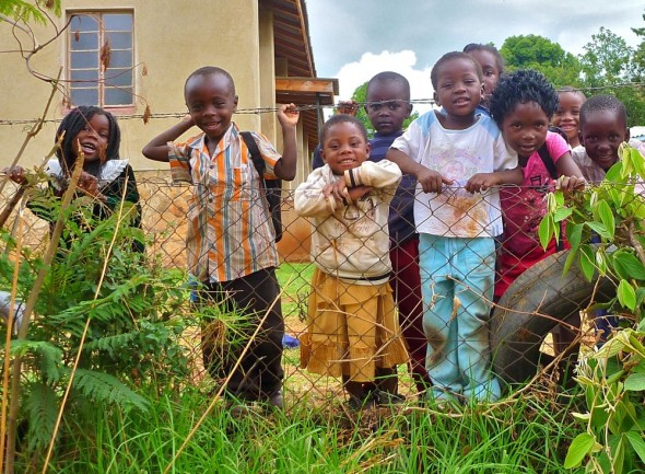 A group of children inside their school fence, Nyanga, Zimbabawe.
