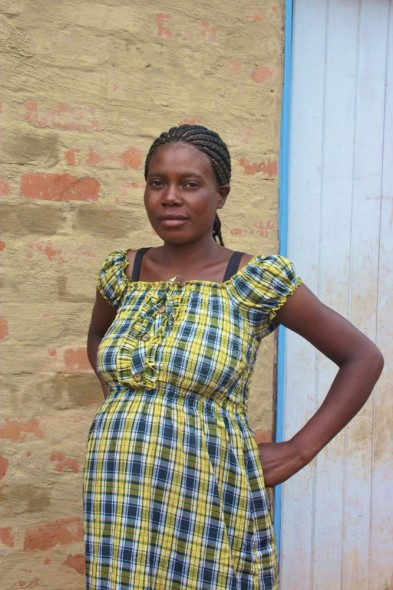 A pregnant woman outside her home in Nyanga, Zimbabwe.