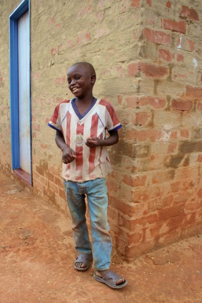 A young boy outside his home in Nyanga, Zimbabwe.