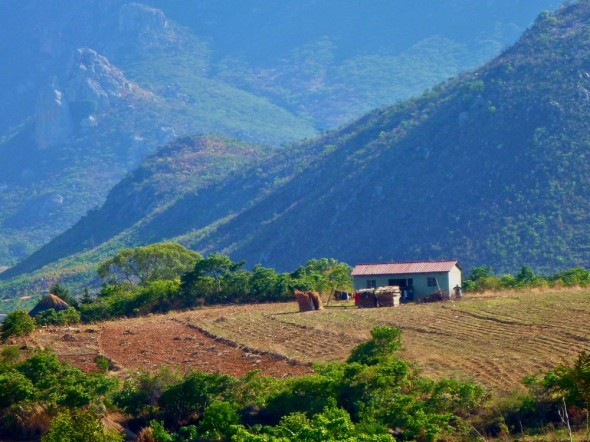 Dreamy blue mountain view with farm and house, Nyanga, Zimbabwe.