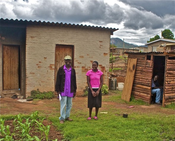 Julius and his sister at their home in Nyanga, Zimbabwe.
