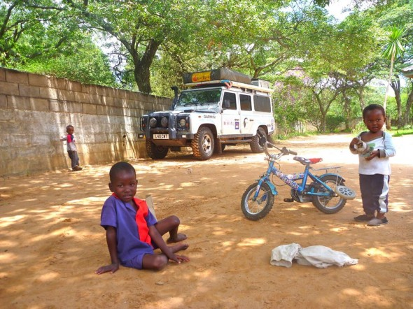 1Outside in Joseph's yard with his children and the Landy, Zimbabwe.