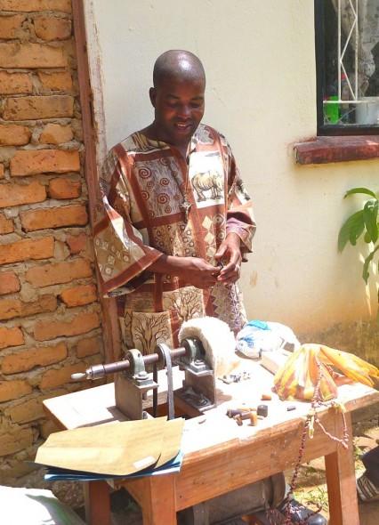 Joseph demonstrating how to use his machine, Zimbabwe.