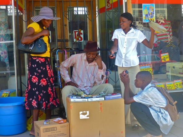 A cool dude selling phones to excited customers on the street, Zimbabwe.