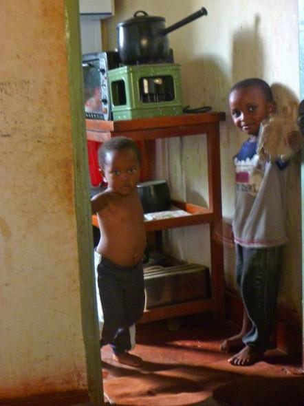 Joseph's children watching us from the kitchen doorway, Zimbabwe.