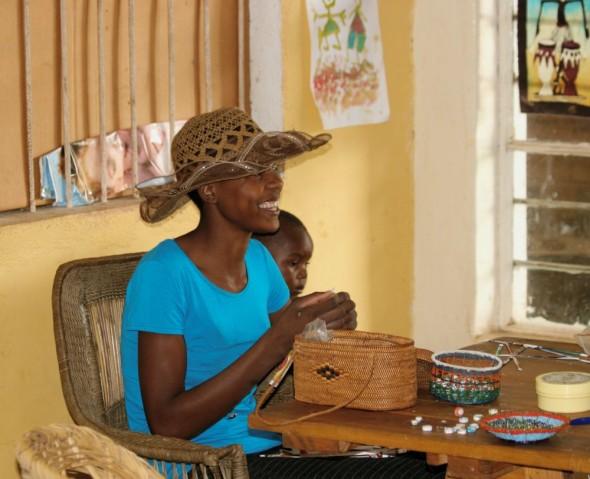 Woman enjoying her work making jewellery, Harare, Zimbabwe