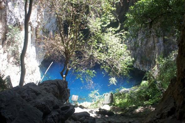View of the clear blue Sleeping Pool and lush vegetation, Chinhoyi Caves, Zimbabwe.