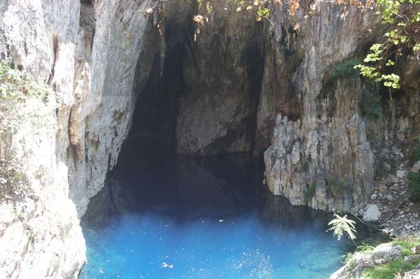 4 Walls surrounding the clear blue Sleeping Pool, Chinhoyi Caves, Zimbabwe.