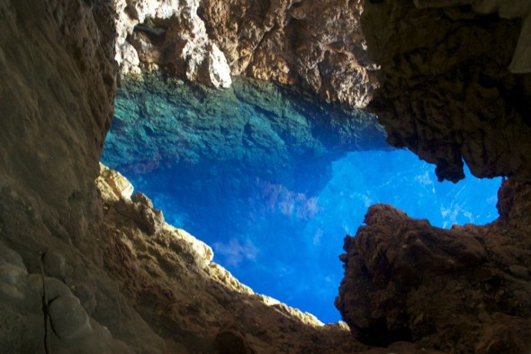 Looking down on the clear blue Sleeping Pool, Chinhoyi Caves, Zimbabwe.