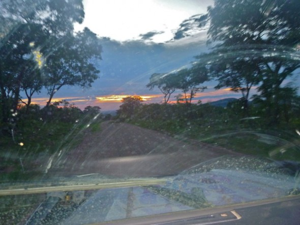 Driving on road to Binga with sunset, Lake Kariba, Zimbabwe