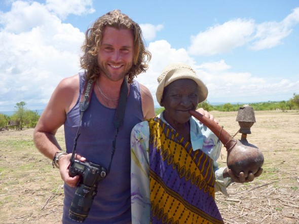 Lachlan with old tonga woman smoking a water pipe, near Binga, Zimbabwe