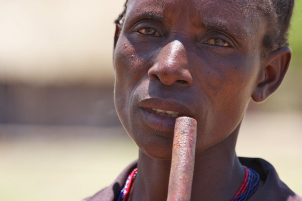 Tonga woman smoking water pipe, near Binga, Zimbabwe