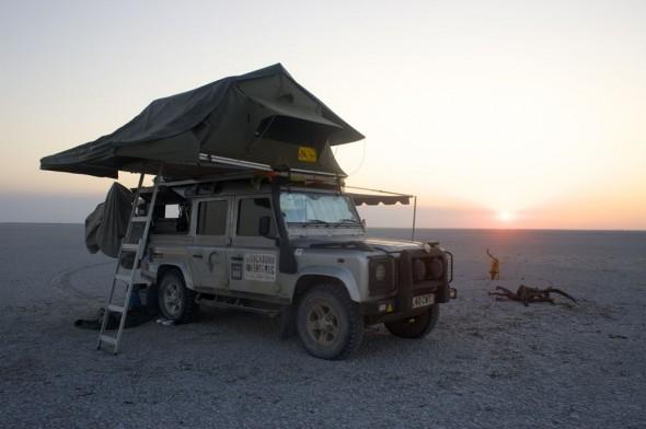 Camping in rooftop tent above Landy, Makhadikhadi Salt Pans, Botswana