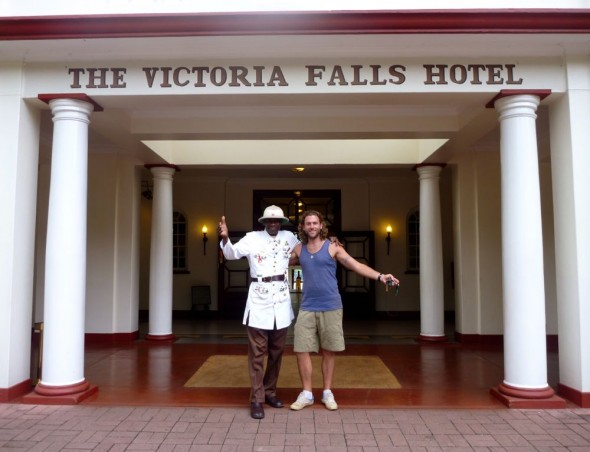 Lachlan outside The Victoria Falls Hotel with the doorman, Zimbabwe