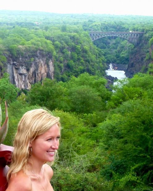 Lucie standing in The Victoria Falls Hotel grounds looking at railway bridge, Zimbabwe