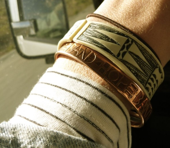 A Band4Hope Band with Himba band on Lucie's wrist in the Land Rover.