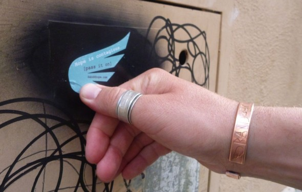 Hamish planting a Band4Hope wing sticker in Rome, Italy. Hope is