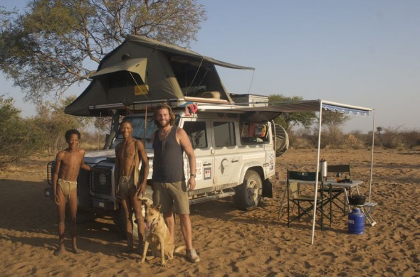 Lachlan and Bow Wow with Bushmen tribe with Land Rover Defender 110 camp setup
