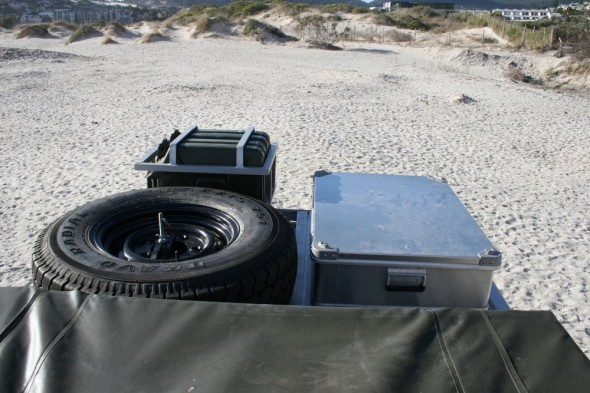 Land Rover Defender 110 roof view with roof tent spare tyre ammo box jerry cans 2