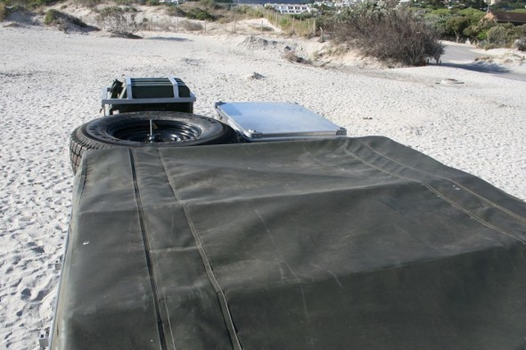 Land Rover Defender 110 roof view with roof tent spare tyre ammo box jerry cans