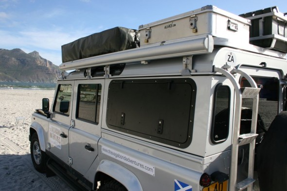 Land Rover Defender 110 with Overland Kit rear side view