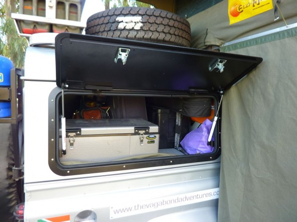 Land Rover Defender 110 with Overland Kit showing side wing open access to fridge freezer