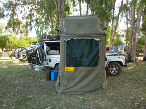 Land Rover Defender 110 with roof tent and additional room