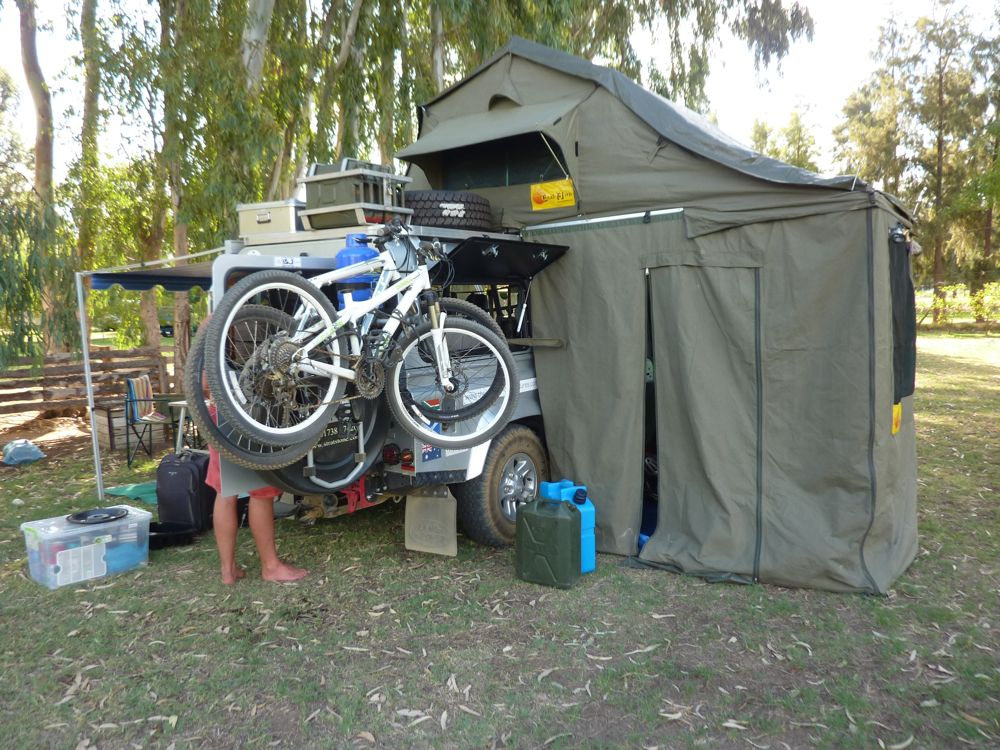 Tent Fully Setup With Additional Room And 2 Mountain Bikes