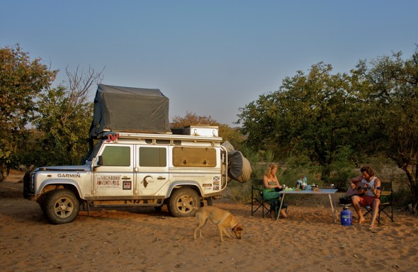 Lucie, Lachlan and Bow Wow with Lula the Landy set up camp on dry riverbed in Kaokoland, Namiba wild no one else around