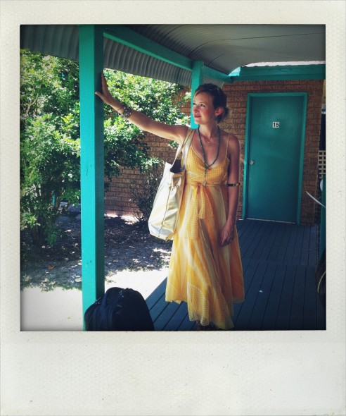 Lucie standing outside the cabin in the caravan park in Byron Bay in Australia. Taken by Miriam McWilliam.
