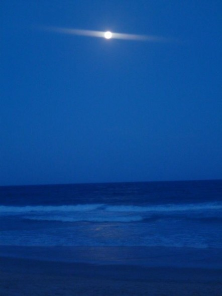 Night stroll along the beach on Braodbeach on the Gold Coat in Australia with full moon.