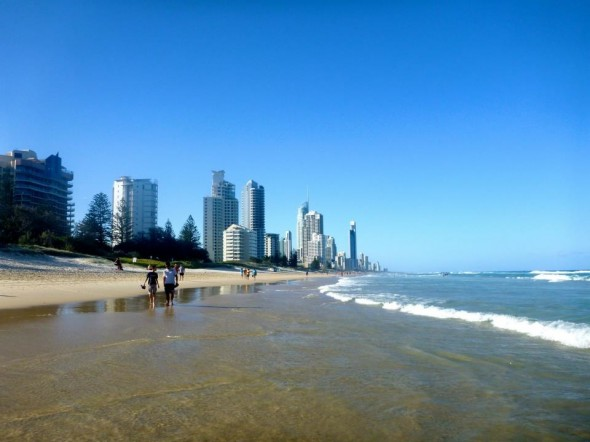 Sunny day at Broadbeach beach on the Gold Coast, Australia with high apartment blocks by the ocean.