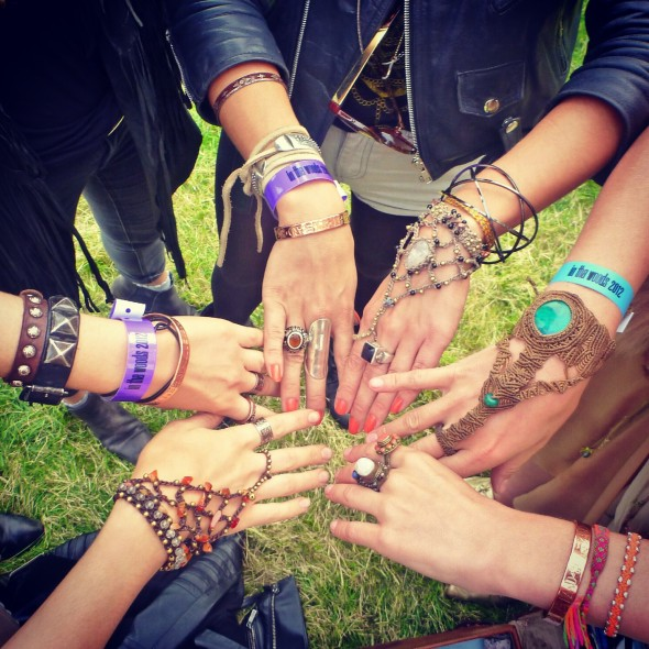Circle of girls wearing Band4Hope wristbands and other bracelets wrist candy at In the Woods Festival
