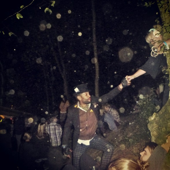 Festival goers at night at In the Woods Festival