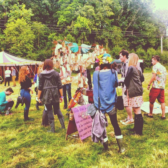 Festival goers gather around the Band4Hope Tree4Hope at In the Woods festival