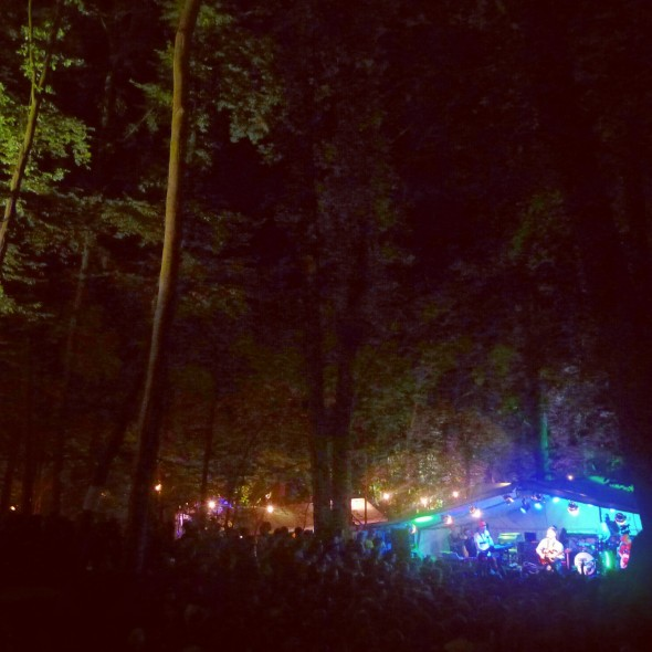 In the Woods Festival at night in the forrest clearing listening to Alt-J