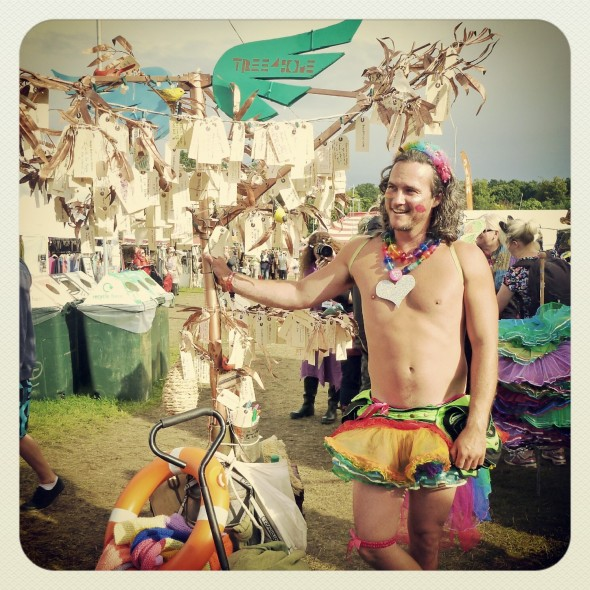 Jester wearing a tutu by the Band4Hope Tree4Hope at Shambala Festival 2012