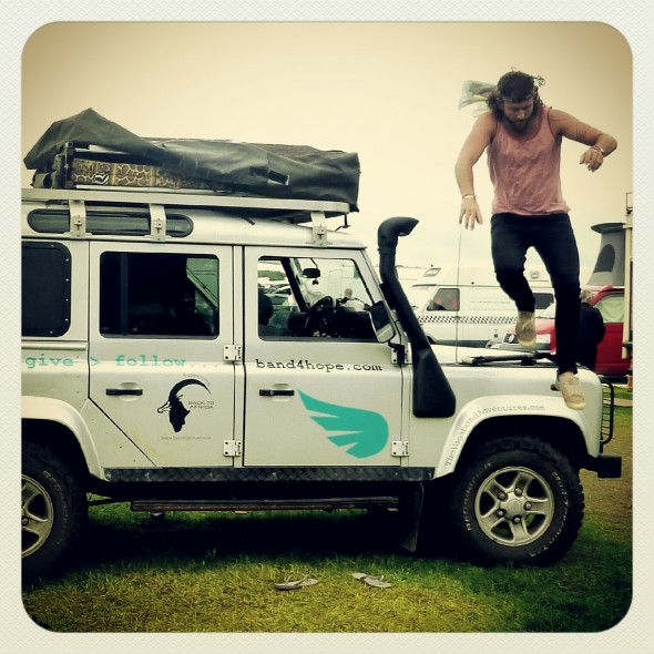 Lachlan McWilliam Band4Hope co-founder jumping off the Hope Truck defender at Shambala Festival 2012