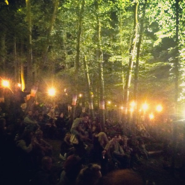 Listening to music at In the Woods festival in the forrest lit by lanterns