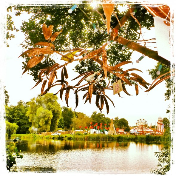 Looking out across the lake to Shambala Festival beneath the Tree4Hope copper branches.