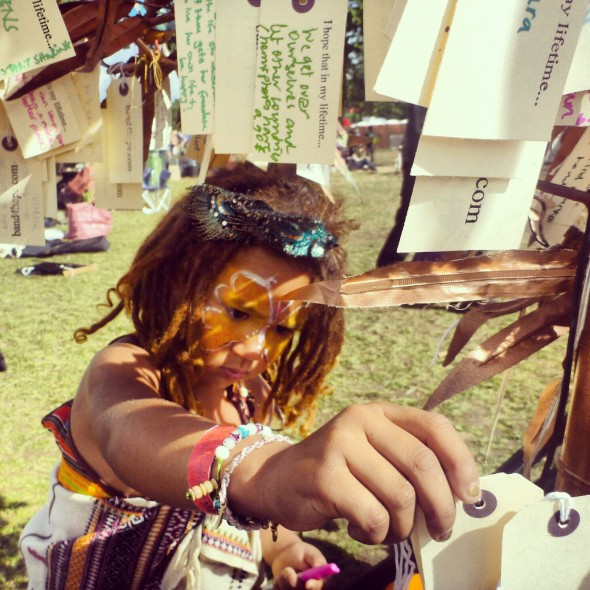 Sangita helping to collect hopes at Shambala Festival 2012 by the Band4Hope Tree4Hope